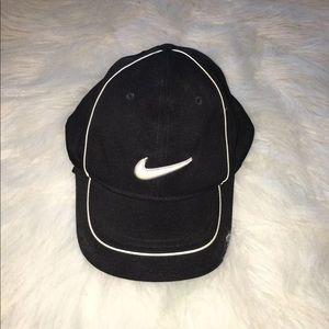 Black Nike Golf Hat with swoosh on back